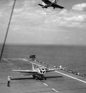 Asisbiz FM 2 Wildcat ACU 30 landing aboard CVE 30 USS Charger 1944 01