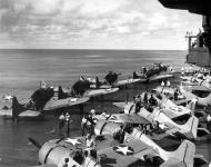 Asisbiz Grumman F4F 3 Wildcat VF 6 Black F23, F14 and F8 being mission readied 1942 01