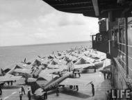 Asisbiz Grumman F4F 3 Wildcat VF 6 White 6F4 and 6F2 being mission readied 01