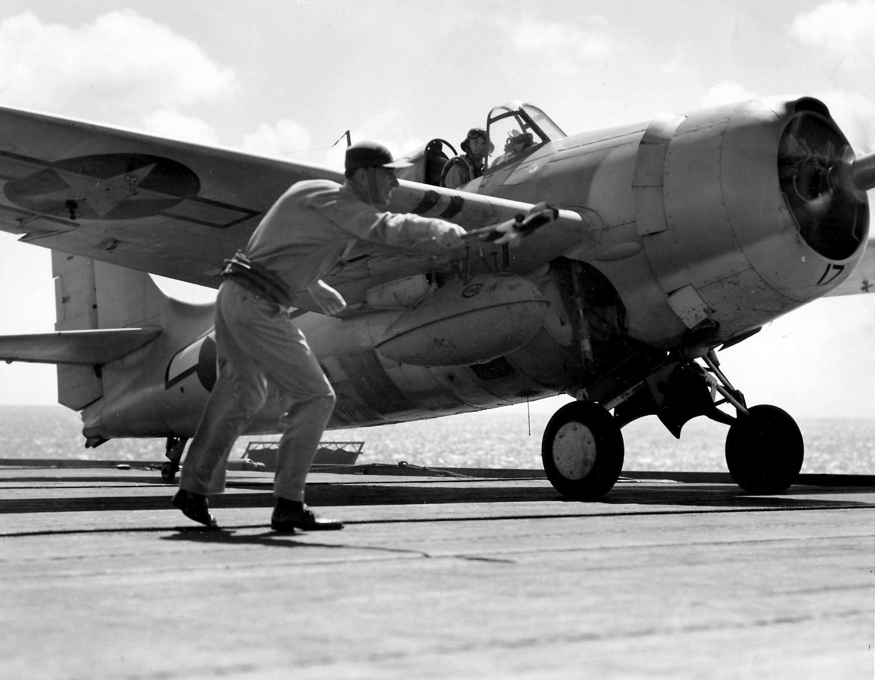 Aircrew Ensign R K Rountree photo series FM 1 Wildcat Black 17 preparing for flight April 1944 01