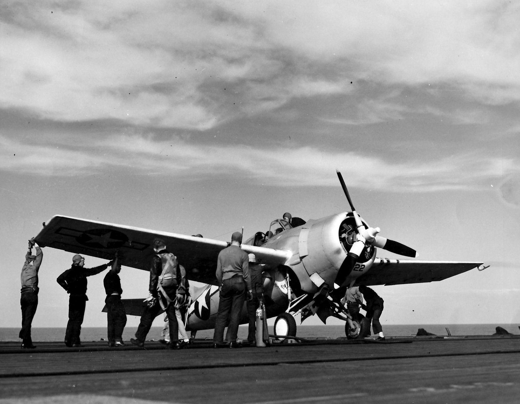 Aircrew Ensign R K Rountree photo series FM 1 Wildcat Black 22 preparing for flight April 1944 01
