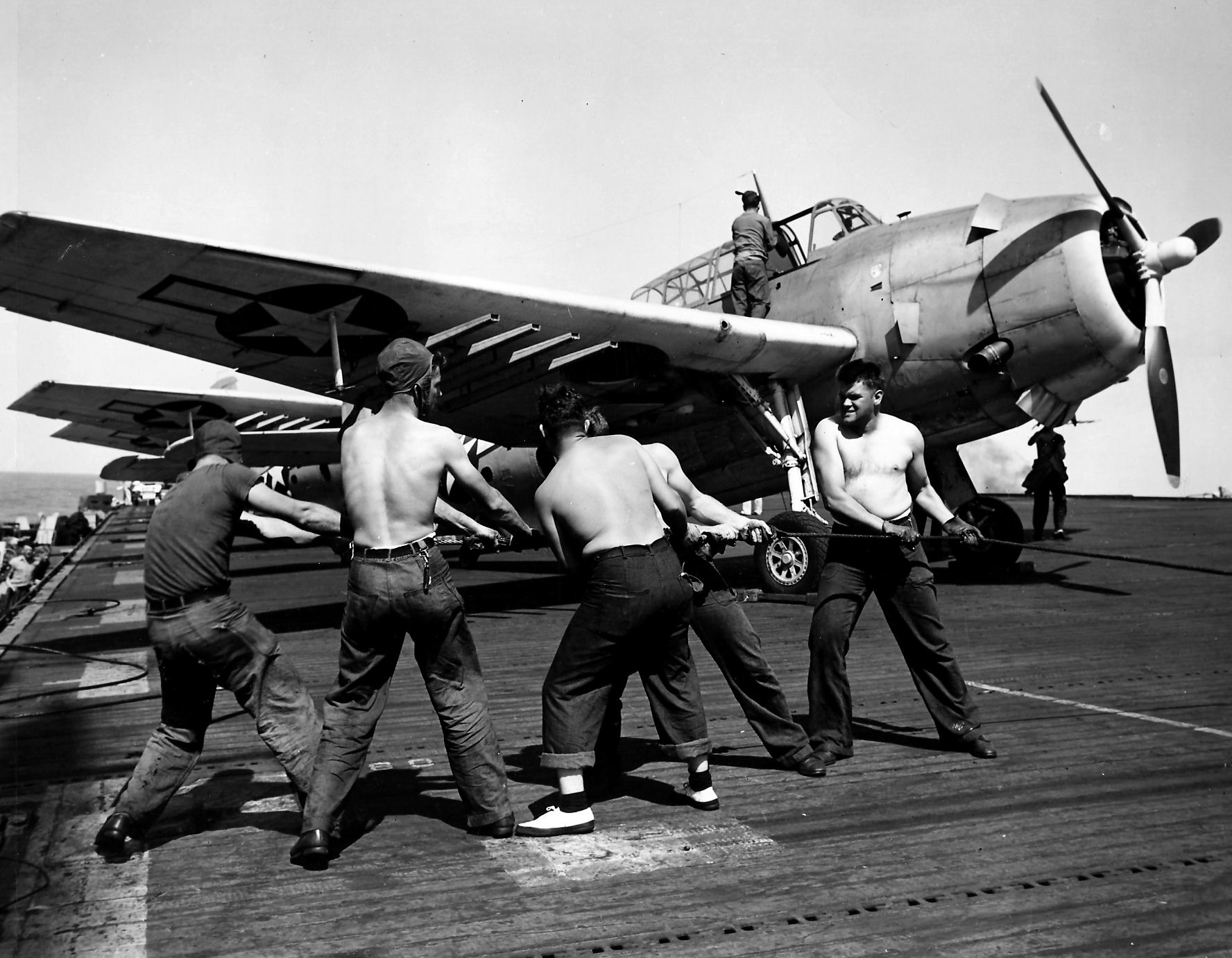 Aircrew TBF Avenger pilot Ensign R K Rountree Avenger on deck photo series April 1944 01