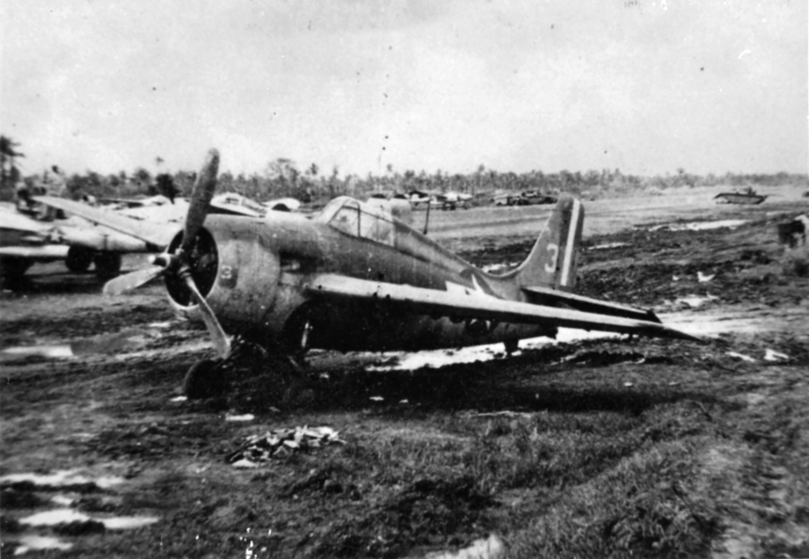 FM 2 Wildcat VC 65 White 3 bogged in mud from CVE 63 USS St Lo 01