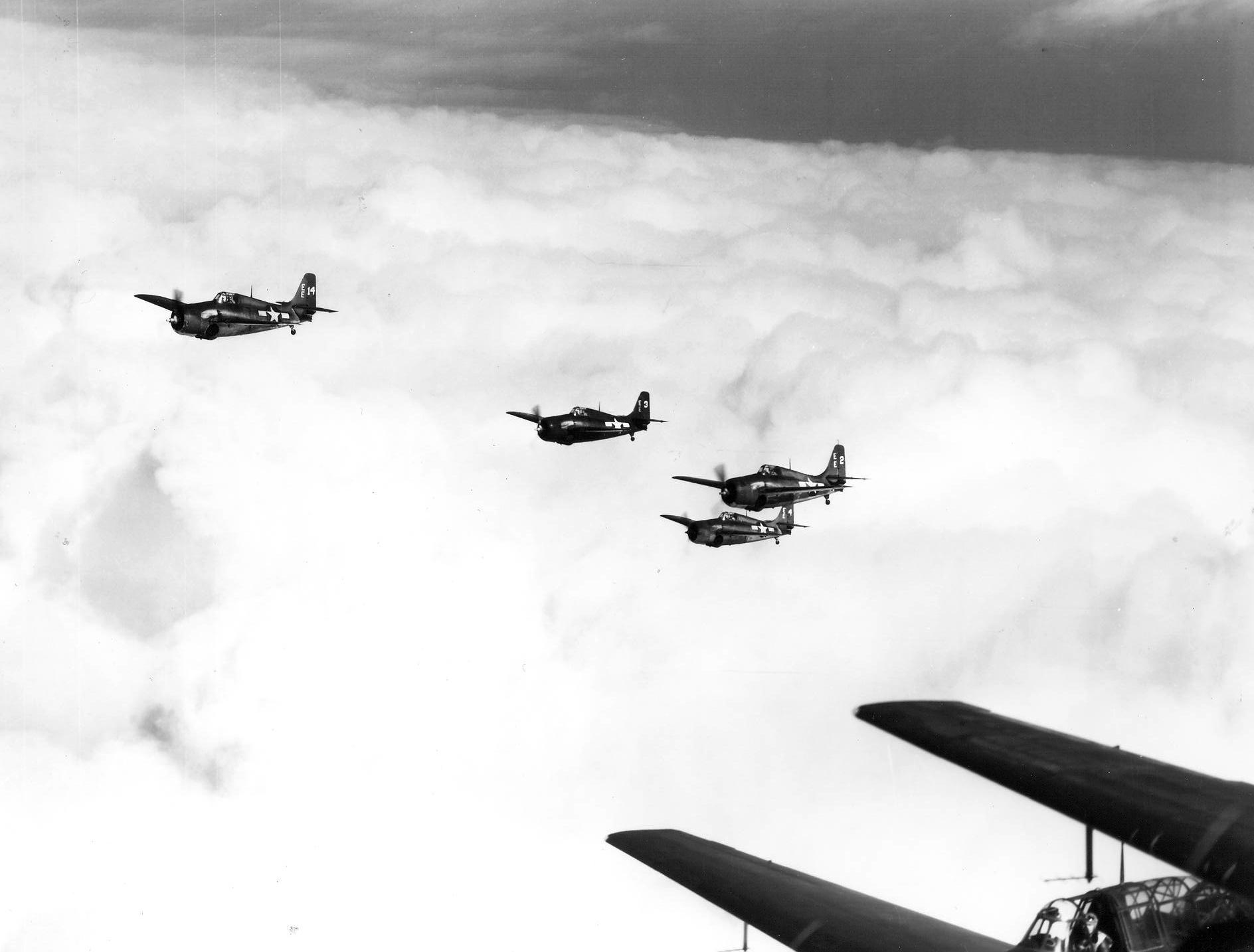 FM 2 Wildcat White EE14,EE3,EE2 and EE4 in flight CVE 101 USS Matanikay Oct 1944 01