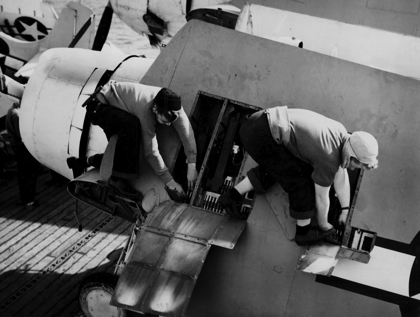 FM 2 Wildcat being rearmed aboard CVE 9 USS Mission Bay 3rd Jan 1944 01