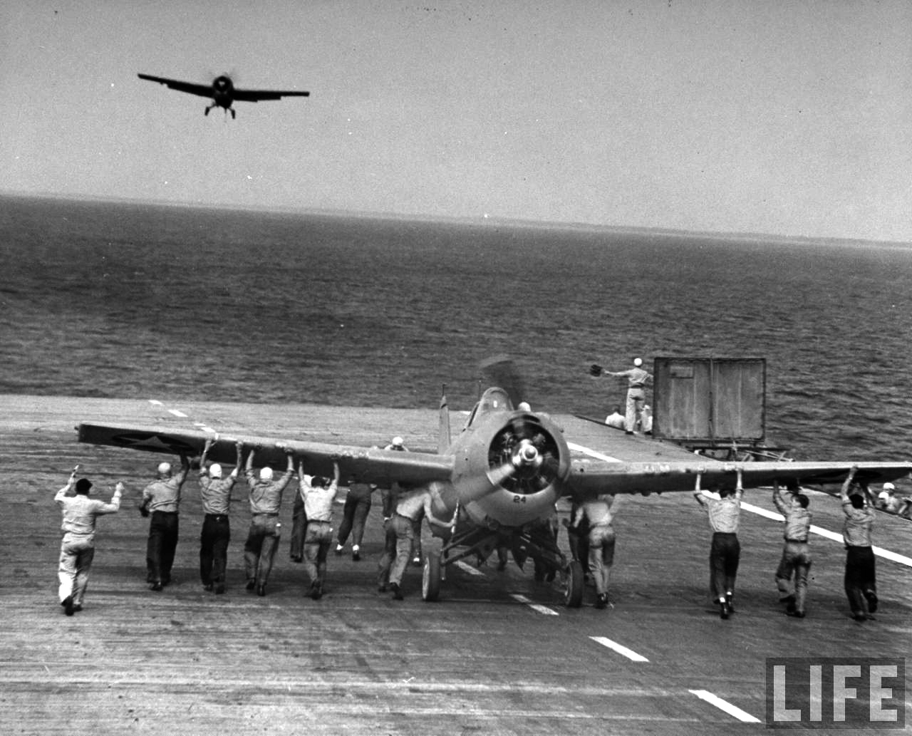 Grumman F4F 3 Wildcat Black 24 being urgently pushed back to clear the deck 01