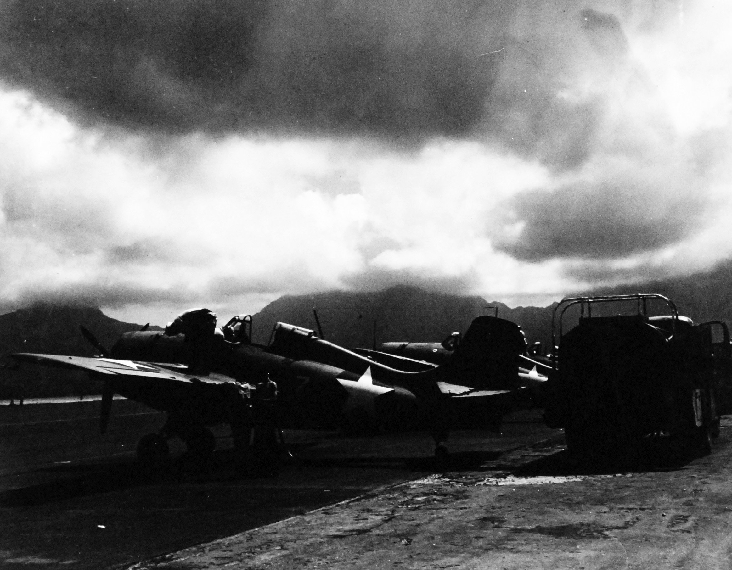Grumman F4F 4 Wildcat White 7 being refueled before a storm hits 01