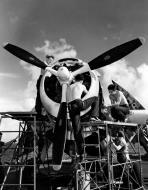 Asisbiz Aircrew TBF Avenger pilot Ensign R K Rountree maintenance crew working on Black 10 April 1944 01