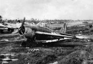 Asisbiz FM 2 Wildcat VC 65 White 3 bogged in mud from CVE 63 USS St Lo 01