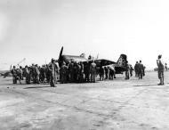Asisbiz FM 2 Wildcat VC 76 White 4 LTJG Noah P Butt Jr first Wildcat to land on Motayama airfield 1 on Iwo Jima Mar 1945 02