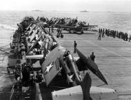 Asisbiz Grumman F4F 4 Wildcat Black 16 and others waiting inline to take off 01