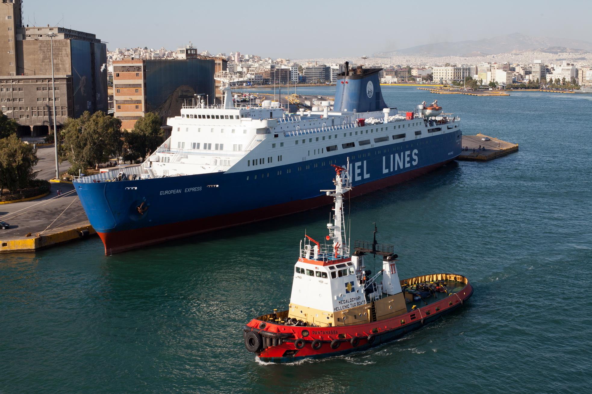 Tugboat Pantanassa IMO 7400936 and MS European Express Limassol Nel Lines Piraeus Athens Greece 01