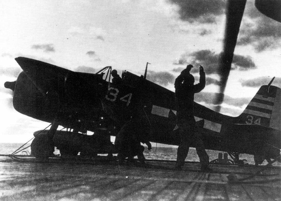 CVL 28 USS Cabot F6F 5 VF 29 white 34 being prepared for a catapult launch 01